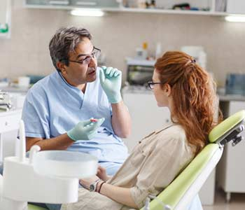Dentist explaining about periodontal Disease to patient